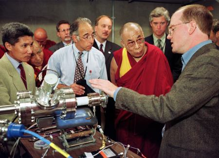 Dalai Lama with industrialists, listening to explanation about a generator