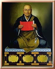 Nichren seated holding scroll