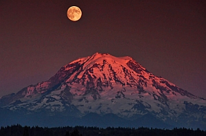 Eclipse moon over mountain