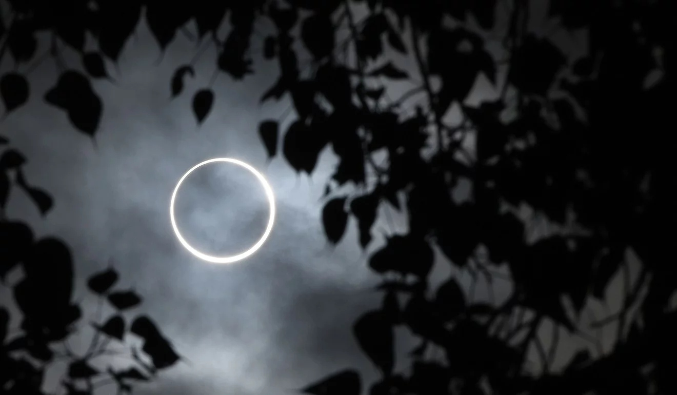 The moon covers the sun in a rare 'ring of fire' solar eclipse as seen from the southern Indian city of Dindigul in Tamil Nadu