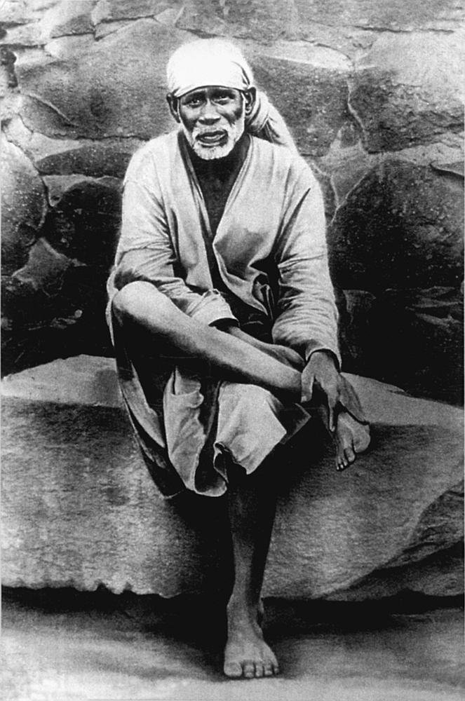 Sai Baba of Shirdi, in pose representing divine sovereignty