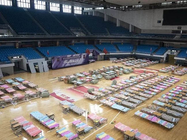 hospital beds in sports stadium, Wuhan, China.