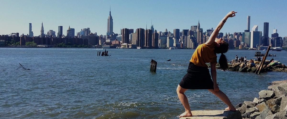 Peaceful Warrior Pose against the New York Skyline